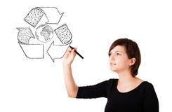 Young woman drawing recycle globe on whiteboard Stock Photography