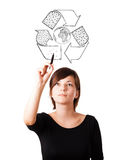 Young woman drawing recycle globe on whiteboard Royalty Free Stock Photos