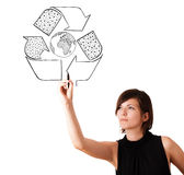 Young woman drawing recycle globe on whiteboard Royalty Free Stock Images