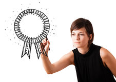 Young woman drawing a ribbon on whiteboard Royalty Free Stock Photo