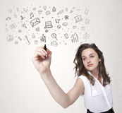 Young woman drawing and sketching icons and symbols Royalty Free Stock Photography