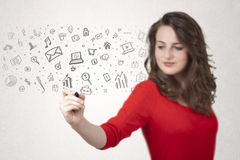Young woman drawing and sketching icons and symbols Stock Photo