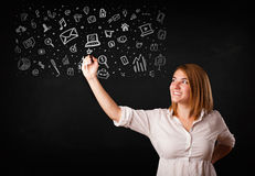 Young woman drawing and sketching icons and symbols Stock Image