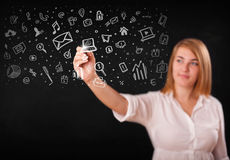 Young woman drawing and sketching icons and symbols Stock Images