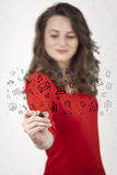 Young woman drawing and sketching icons and symbols Royalty Free Stock Image
