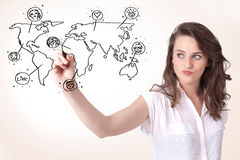 Young woman drawing a social map on whiteboard Stock Photography