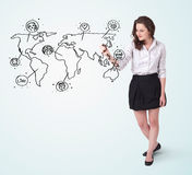 Young woman drawing a social map on whiteboard Royalty Free Stock Photo