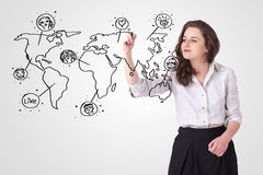 Young woman drawing a social map on whiteboard Stock Images