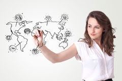 Young woman drawing a social map on whiteboard Royalty Free Stock Photos