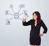 Woman drawing social network icons on whiteboard Stock Images