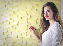 Young woman drawing on some post-it Stock Photos