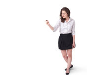 Young woman drawing on wihteboard. With white copyspace Stock Image