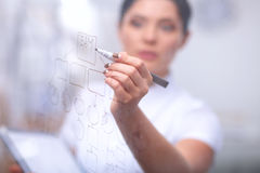 Young woman drawing on wihteboard with white Stock Photo