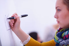 Young woman drawing on wihteboard with white Stock Images