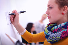 Young woman drawing on wihteboard with white Royalty Free Stock Photography
