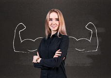 Young woman with drawn powerful hands Royalty Free Stock Image
