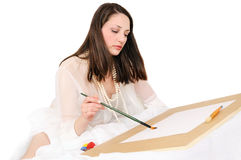 Young woman draws a brush Royalty Free Stock Images