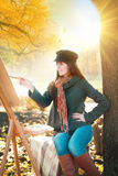 The young  woman draws a landscape in nature Stock Photography