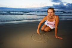 Young woman draws smile Royalty Free Stock Images
