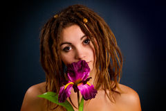 Young woman with dreadlocks against a dark background Royalty Free Stock Images
