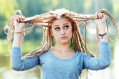 Young woman with dreadlocks Royalty Free Stock Image