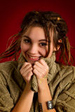 Young woman with dreadlocks on a red background Stock Images