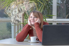 Young woman is dreamily looking at US dollars Royalty Free Stock Image