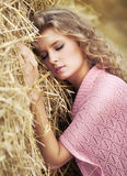Young woman dreaming. In autumn meadow Stock Image