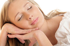 Young woman dreaming. Portrait of young woman dreaming with closed eyes Royalty Free Stock Photo
