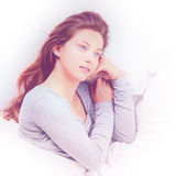 Young Woman dreaming in bed. Relaxed young woman dreaming in bed in morning. image with toning Stock Photo