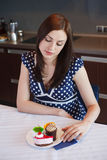 Young woman is dreaming about cake. Young woman is dreaming about eating cake Royalty Free Stock Photo