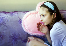 Young woman dreaming on couch Stock Photography