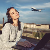 Young woman dreaming about flying. Air ticket ordering Royalty Free Stock Photo
