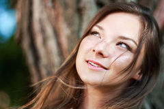 Young woman dreaming. Headshot of young woman dreaming on nature Royalty Free Stock Images