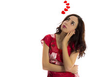 Young woman dreaming of her lover. Young woman dreaming of love  with hearts flying around her for Valentines Day and love concept Stock Photography
