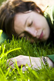 Young Woman Dreaming In The Grass Stock Image