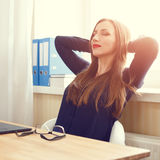 Young woman dreaming near window sitting in chair Royalty Free Stock Photos