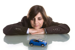 Young woman dreaming with new car Stock Images
