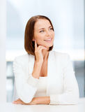 Young woman dreaming in office. Business concept - young woman dreaming in office Stock Photography