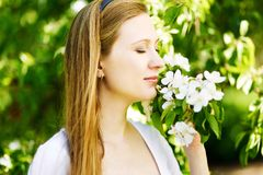 Young woman dreaming outdoors Stock Photo