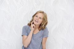 Young woman dreaming and smiling. Beautiful thoughtful young woman dreaming and smiling Royalty Free Stock Photography
