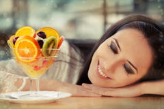 Young Woman Dreaming With Fruit Salad Dessert Stock Image