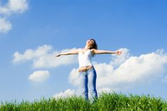 Young woman dreams to fly on winds. Happy young woman dreams to fly on winds Royalty Free Stock Images