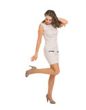 Young woman in dress adjusting shoe Royalty Free Stock Photos