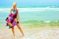 Young woman in dress on beach Royalty Free Stock Photography