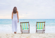 Young woman in a dress on the beach Stock Image