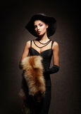 A young woman in a dress with fur Stock Photography
