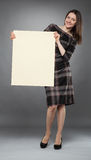 Young woman in dress  holding placard Stock Images