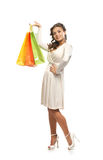 A young woman in a dress holding shopping bags Stock Images
