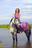 Young woman in a dress on a horse Royalty Free Stock Image